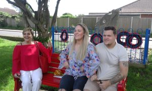 Family of Postie Jay sat on a bench