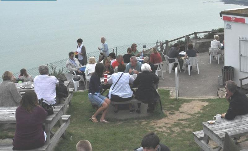 A photo of Cliff Top Cafe customers sat outside