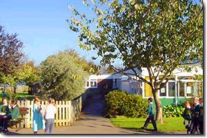 A photo of the main Capel-le-Ferne school building